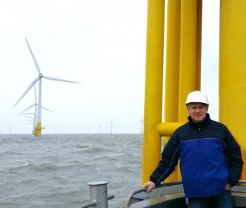 Charles A Donadio Jr Standing Next To One Of The 30 Wind Turbines At Scroby Sands Farm In Great Yarmouth United Kingdom On March 18 2015