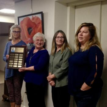 Wellness accepts award